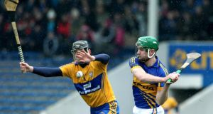 Tipperary's Noel McGrath and Patrick Donnellan of Clare at Semple Stadium. Photograph: Lorraine O'Sullivan/Inpho
