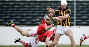 Kilkenny's Michael Fennelly is tackled by Paudie O'Sullivan of Cork at Nowlan Park. Photograph: Cathal Noonan/Inpho
