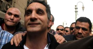 "Bassem Youssef: poked fun at Mr Morsi's repeated use of the word ""love"" by singing a love song to a red pillow with the president's face printed on it. Photograph: Reuters"