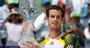 Andy Murray raises  the champion's trophy after defeating Spain's David Ferrer  at the Sony Open  in Key Biscayne, Florida. Photograph: Andrew Innerarity/Reuters