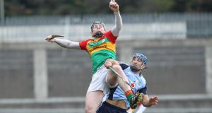 Carlow's John Michael Nolan wins a ball in the air under pressure from Dublin's Stephen Hiney.