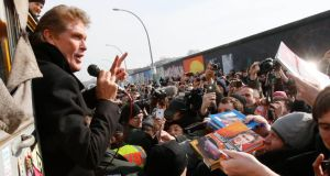 "American actor and singer David Hasselhoff flashes a victory sign as he attends a demonstration along the open air 0.8-mile painted section of the Berlin Wall known as the ""East Side Gallery"". Developers plan to build luxury apartments close to the East Side Gallery, which is adorned with the work of artists such as Keith Haring and Gerald Scarfe, but builders had to stop tearing down the wall due to protests last weeks. Photograph: Tobias Schwarz/Reuters"