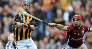Galway's Fergal Moore (right) with Eoin Larkin of Kilkenny. Photograph: Dan Sheridan/Inpho