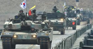 South Korean tanks move over a temporary bridge during a river-crossing military drill in Hwacheon near the border with North Korea yesterday. Photograph: Kim Jae-Hwan/AFP/Getty Images