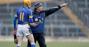 Tipperary manager Eamon O'Shea gives Lar Corbett instructions at Semple Stadium on Sunday.  Photograph: Lorraine O'Sullivan/Inpho