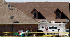 The home of Kaufman county district attorney Mike McLelland is surrounded by police tape in Forney, Texas, yesterday. Photograph: Reuters