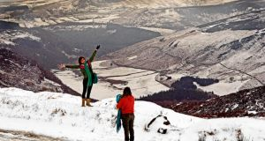 Tourists enjoy the snowfall at Sally Gap, Co Wicklow. Temperatures during March were well below normal everywhere in the State, according to preliminary figures from Met Éireann. Photograph: Eric Luke
