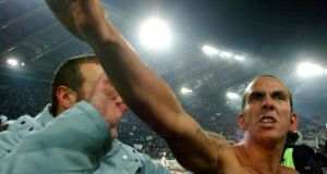 Paolo Di Canio salutes Lazio supporters at the  Olympic Stadium after victory over Roma.