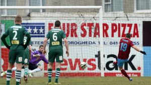 Drogheda's Declan O'Brien scores a late penalty. Photograph: Inpho