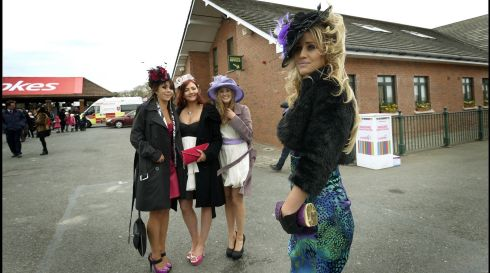 Ladies in waiting: Out front is Elaine Murphy from Kilkenny with, from left, Michelle Maher and Aine O'Donovan of Tipperary, and Ena Currans of Kilkenny,  at Fairyhouse. Photograph: Brenda Fitzsimons/The Irish Times