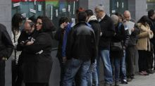 People wait outside an unemployment office in Madrid, Spain today. Spanish government figures show that the number of people registered as unemployed edged down by a little under 5,000 in March, the first reduction for the month in five years. Photograph: Andres Kudacki/AP