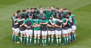 Declan Kidney talks to his team in a huddle before the Scotland game at the Aviva Stadium in March 2012. Photograph: Billy Stickland/Inpho
