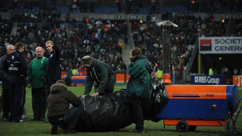 Kidney talks to officials as groundsmen use a heater to warm areas of the pitch during the RBS 6 Nations match between France and Ireland at Stade de France on February 11th, 2012 in Paris. Photograph: Christopher Lee/Getty Images