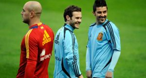 Spain's players Jose Reina (left, Juan Mata (centre) and David Villa at a recent Spanish training session.  Photograph: Eloy Alonso/Reuters