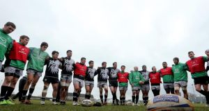 Connacht team in a huddle after a training session. Photograph: James Crombie/Inpho