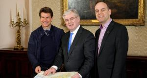 Tom Cruise with Tanaiste and Minister for Foreign Affairs Eamon Gilmore and Mark Henry of Tourism Ireland at the Department of Foreign Affairs in Dublin. Photograph:Shane O'Neill/Fennells/PA Wire