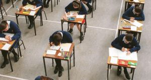 Junior Cert take a  maths examination at St. Raphaela's School, Stillorgan.