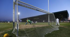 Kildare's Paddy Brophy scores a penalty against Longford in O'Moore Park. Photograph: Lorraine O'Sullivan/Inpho