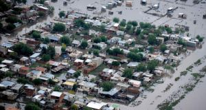 An aerial view of flooded streets is pictured after heavy rains in La Plata. At least 48 people are reported to have died in the provincial capital 30 miles from Buenos Aires. Photograph: Reuters