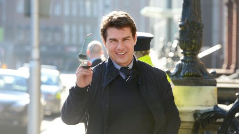 You guys! Always there wherever I go!... Tom Cruise acknowledges the paparazzi on his arrival at Iveagh House on Dublin's St Stephen's Green to recieve his certificate of Irishness. He is also in town for the premiere of his latest movie, Oblivion. Photograph: Alan Betson/The Irish  Times