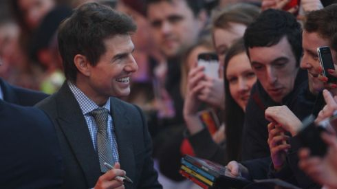 You want me to autograph the entire box set? Sheesh! Tom Cruise meets fans on the red carpet for the premiere of Oblivion, at the Savoy Theatre, Dublin. Photograph: Artur Widak/PA Wire
