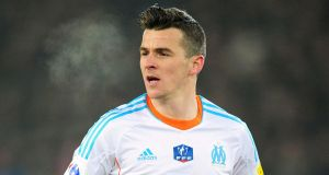 Marseille coach Elie Baup says Joey Barton remains a key member of his squad despite tweets. Photograph: Adam Davy/PA Wire