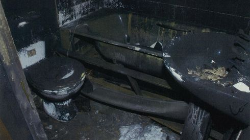 An undated handout photo from the Crown Prosecution Service of the bathroom at the house at Victory Road, Allenton, Derby after a fire in which the six Philpott children died. Photograph: CPS/PA Wire