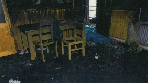 The front room of the house in the aftermath of the fire.  Photograph: CPS/PA Wire