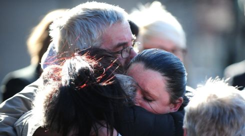 Jimmy Duffy, father of Mairead Philpott, hugs family members outside Nottingham Crown Court after Mick and Mairead Philpott are convicted. Photograph: Rui Vieira/PA Wire