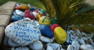 Well-wishers have been leaving goodwill messages written on stones and placed inside planters outside of former South Africa President Nelson Mandela's residence  in Johannesburg, South Africa. Photograph: Chip Somodevilla/Getty Images