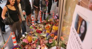 Floral tributes to Jill Meagher outside the Duchess boutique in Melbourne, the store which captured the last CCTV footage of her. Photograph: Scott Barbour/Getty Images