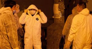 Technicians wearing protection suits begin to cull poultry at Huhuai poultry wholesale market, where the H7N9 bird flu virus was detected in pigeon samples, in Shanghai today. Photograph: Reuters