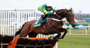 My Tent Or Yours ridden by AP McCoy clears the last to win the Rose Appeal Supports Alder Hey Top Novices Hurdle race during Ladies Day at the 2013 John Smith's Grand National Meeting at Aintree. Photograph: Anna Gowthorpe/PA Wire