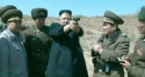 North Korean leader Kim Jong-un holds up a pistol as he supervises  North Korea People's Army firing drills, in this still image taken from video footage released yesterday by the North's state-run television KRT. Photograph: Reuters