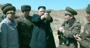 North Korea's leader Kim Jong-un holds up a pistol as he supervises firing drills with the  North Korea People's Army (KPA), in this still image taken from video footage released by the North's state-run television KRT yesterday