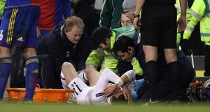 Tottenham Hotspur's Gareth Bale being treated on the pitch in the Europa League tie with FC Basel. Photograph: John Walton/PA Wire