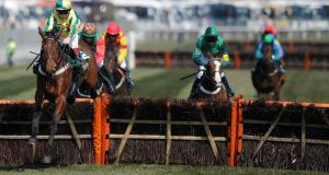 Jamie Moore riding Ubak clear the last to win The John Smith's Mersey Novices' Hurdle Race at Aintree. Photograph:  Alan Crowhurst/Getty Images