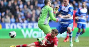 Jay Rodriguez slides in to score  the opening goal for Southampton in the Premier League clash  against Reading at the Madejski Stadium. Photograph: Ian Walton/Getty Images