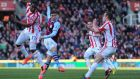 Matthew Lowton of Aston Villa scores his team's second goal in the Premier League clash against Stoke City  at the Britannia Stadium. Photograph: Chris Brunskill/Getty Images