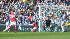 Arsenal's Tomas Rosicky (centre) scores against West Bromwich Albion at The Hawthorns.  Photographaph: Martin Rickett/PA Wire