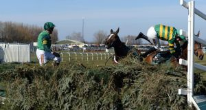 Barry Geraghty and Roberto Goldback block Sunnyhillboy and Richie McLernon (right) at the final fence in the john Smith's Grand National. Photograph: John Giles/PA Wire