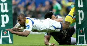 Clermont's Sitiveni Sivivatu dives to score his side's third try despite the tackle of Montpellier's Alex Tulou at  Stade Marcel Michelin.  Photograph: James Crombie/Inpho