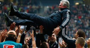 Bayern Munich's players throw coach Jupp Heynckes in the air after winning their German  Bundesliga with victory over Eintracht Frankfurt. Photograph: Kai Pfaffenbach/Reuters