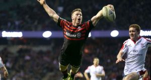 Chris Ashton dives in to score Saracens' second try in the Heineken Cup quarter-final victory at Twickenham. Photograpgh: Billy Stickland/Inpho