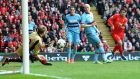 Liverpool's Luis Suarez shoots at goal during the  Premier League match against West Ham  at Anfield. Photograph:  Martin Rickett/PA