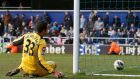 QPR goalkeeper Julio Cesar reacts after he was beaten by a late free-kick from Wigan's Shaun Maloney  at Loftus Road. Photograph: Suzanne Plunkett/Reuters
