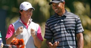 Rory McIlroy has a laugh with   playing partner Tiger Woodsat the  WGC-Cadillac Championship  in Doral, Florida, recently. A happier Woods is back to his best. Photograph:  Andrew Innerarity/Reuters