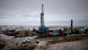 An oil derrick at a fracking site for extracting oil outside of Williston, North Dakota. The price of oil rose today after reaching an 8-month low last week.  Photograph: Shannon Stapleton/Reuters