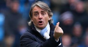 Manchester City manager Roberto Mancini. Photograph:  Alex Livesey/Getty Images