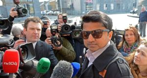 Praveen Halappanavar is asked questions by the media outside the  inquest into her death in Galway this morning. Photograph: Eric Luke/The Irish Times